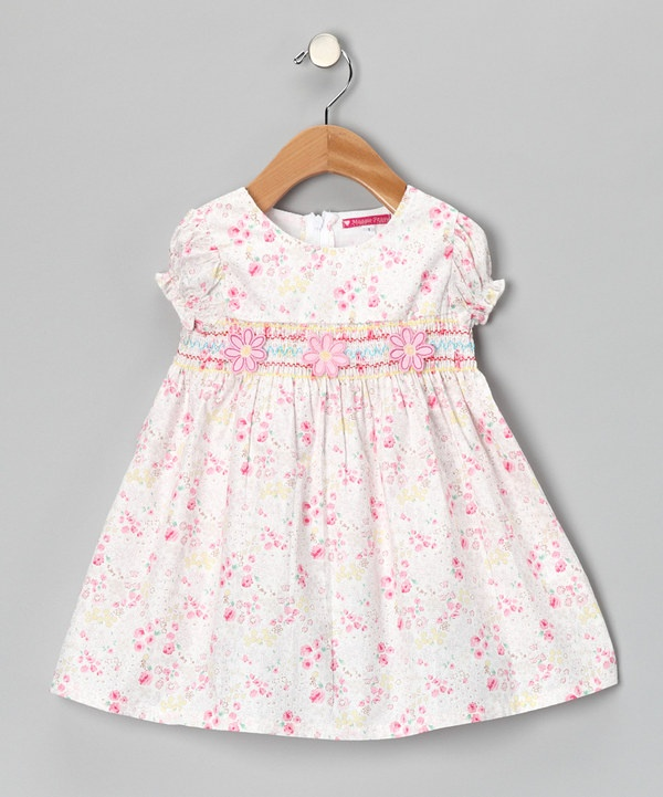 Take a look at this Cream Smocked Floral Dress - Girls on zulily today!