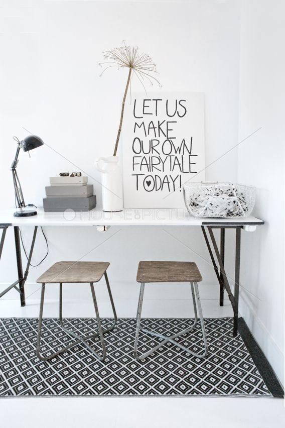Loving this black-and-white desk nook, with vintage industrial stools and that black-and-white geo rug.