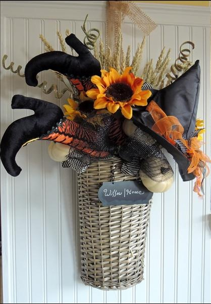 Halloween door bucket - basket.  http://susiev.store.willowhouse.com/search.aspx?keyword=basket  Inspired by http://www.etsy.com/shop/PetalsnPlumes?ref=exp_listing -- Too Cute!