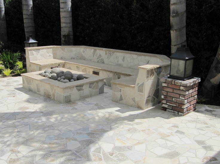great outdoor sitting area and fire pit outside home