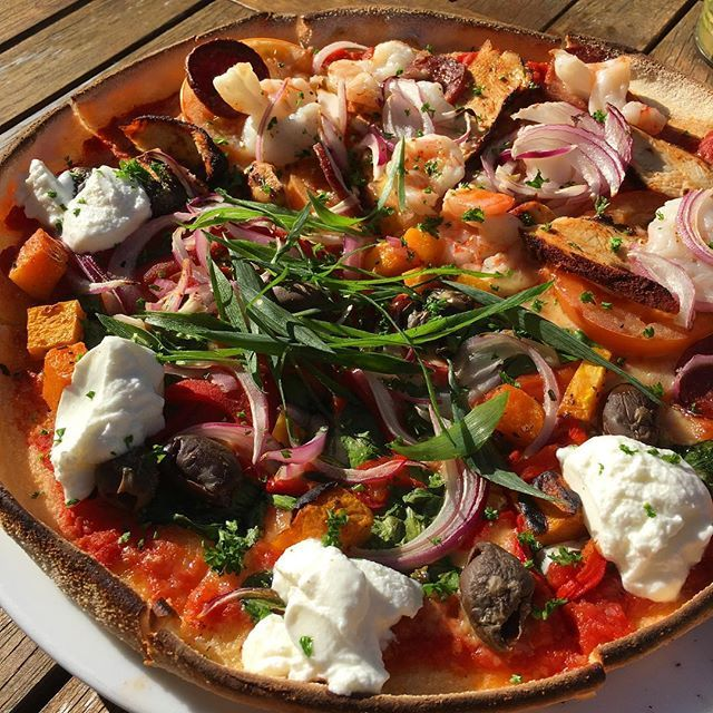 "Digging into this amazing ""Grumpy Goat"" pizza under the winter sun in Hahndorf. Happy birthday Queenie! Hayley X"