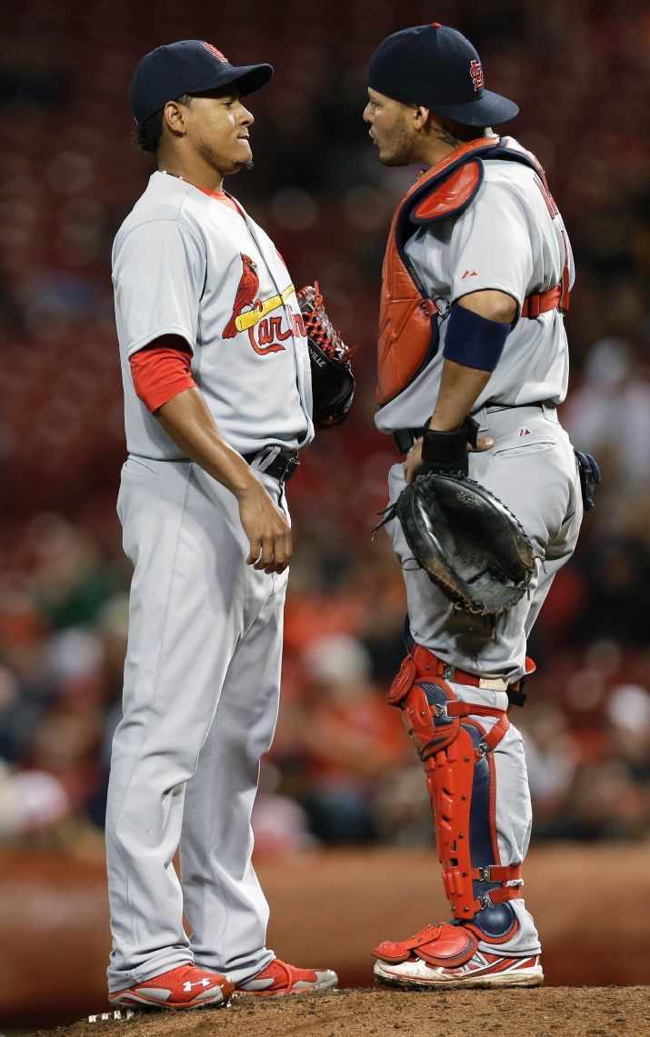 relief pitcher Carlos Martinez talks with catcher Yadier Molina in the eighth inning of a baseball game against the Cincinnati Reds. Cards lost 1-0. 4-02-14