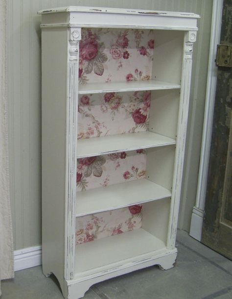shabby a plain bookcase with wallpaper and details. Love the idea of dressing up a plain white bookcase with wallpaper or contact paper on the back!