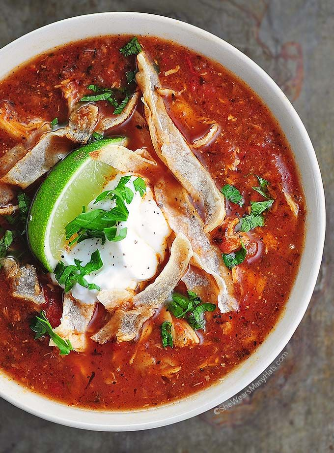 Easy Chicken Tortilla Soup Recipe is full of spicy flavor and a great main dish hearty soup. Comfort food with color and flavor!