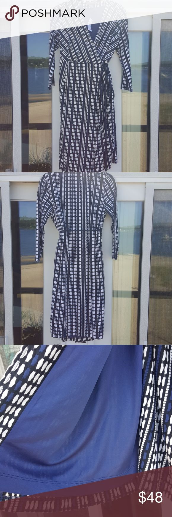 NWT Chic momma! This BRAND NEW WITH TAGS MATERNITY wrap dress is super chic.  Fully lined with a cool pattern of blue, white and black.  Great for work or a night out.  *A Pea in the Pod recommends that you purchase your regular pre- pregnancy size USA.  Dress was originally $128, marked down to $99.99 A Pea in the Pod Dresses