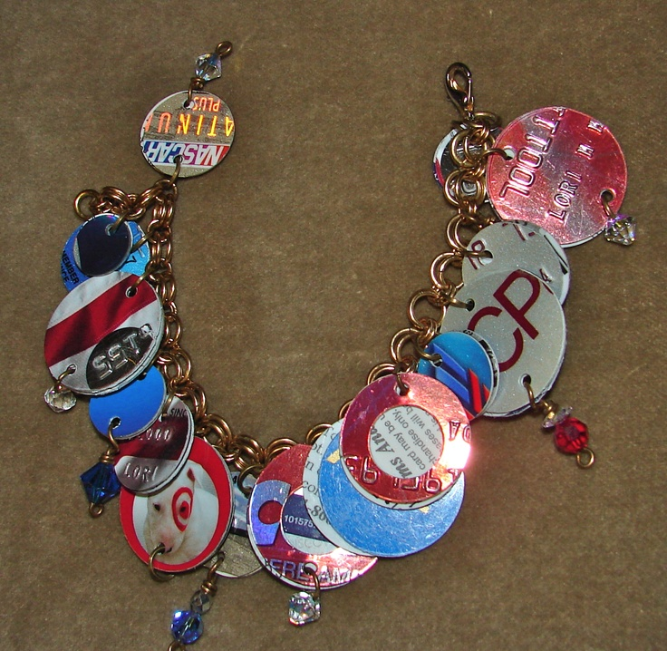 Charm bracelet from old credit cards and gift cards.