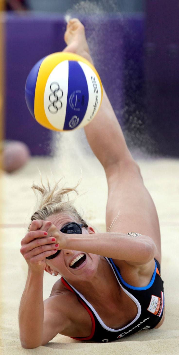 Sophie Van Gestel of the Netherlands digs out a ball during a beach volleyball match against Brazil at the 2012 Summer Olympics