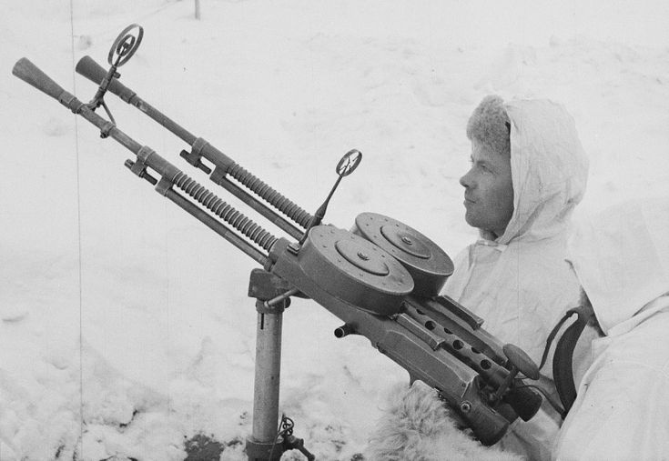 Finnish soldiers in winter camouflage have captured Soviet 7.62-mm aircraft gun YES-2