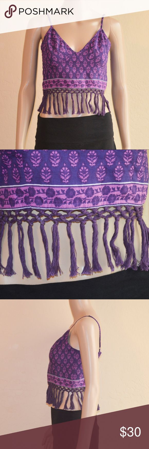 """Free People One Purple Eastern Fringe Bralette FP One printed bralette/crop with fringe trimming all around the bottom hem. Stretchy smocking at the back. Adjustable shoulder straps.   Size: M  Measurements Laying Flat -  Underarm to Underarm: 16 1/2"""" Shoulder to Hem: 16 1/2"""" (bottom of fringe)  Material: 100% Cotton  Condition: NWOT. Never worn, recently purchased. Small white mark on the lattice fringe (will come out when cleaned). Free People Tops Crop Tops"""