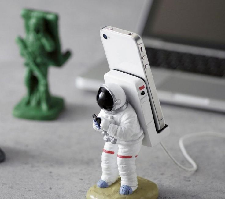 The astronaut iPhone stand is an iPhone dock that will charge your iPhone that l…