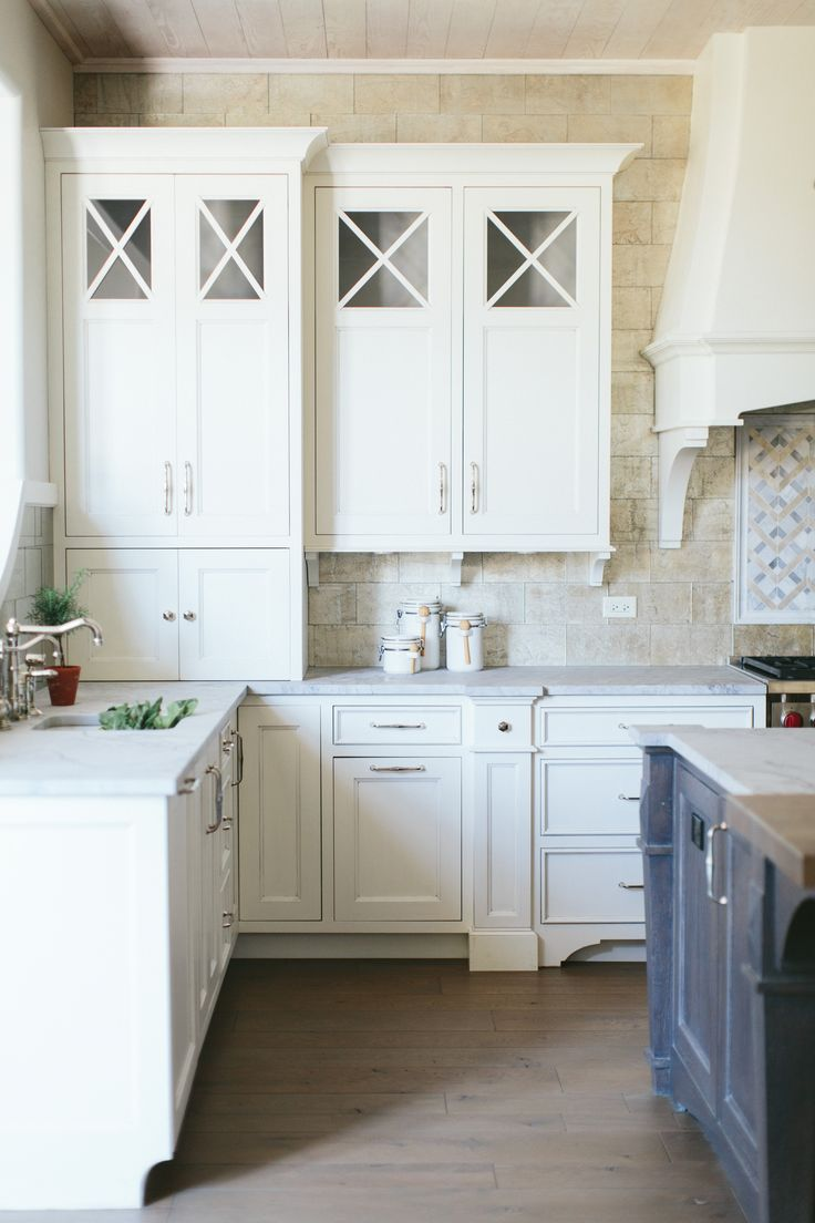 284 best kate marker interiors images on pinterest diving who doesn t love a white kitchen this antiqued mirrored backsplash from took this kitchen up a notch