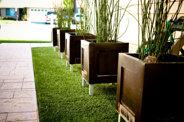 Artificial turf and raised planter boxes.  No mowing!! Yes!!!