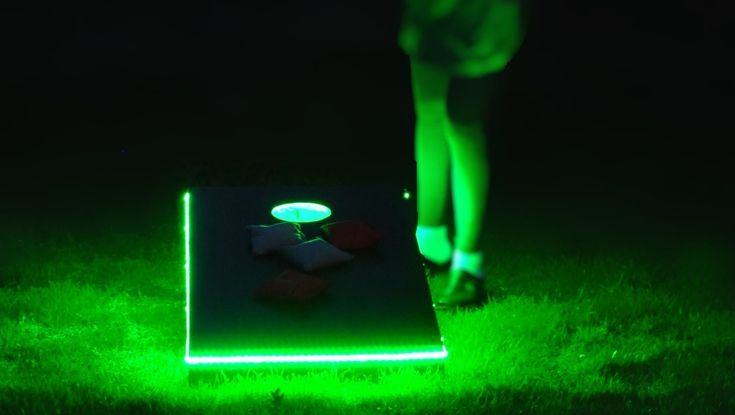 """Make your own """"Moonlight Corn-Hole"""" toss-across game. I like how it's lit for night play. Bean bags are filled with corn kernals, natch. And as the article points out: """"This is a game where you never have to put down your beer."""""""