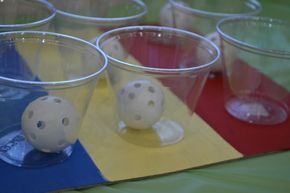 Cheap, easy, and brilliant DIY carnival game.Plastic cups hot glued onto cardboard for ping pong toss game. Put different colored paper on the bottom of each cup to determine their prize.
