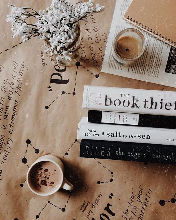 Love this cozy picture of books and hot chocolate. Makes us ready for fall reading!