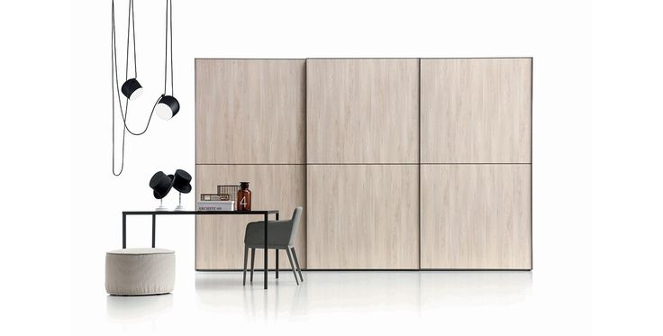 Dover, Wardrobes, Products   Novamobili.  Lines are highlighted on the wardrobe with Dover sliding doors. Available in all matt lacquered colours, in textured, eco-wood and super-matt finishes. Profile available in brushed steel, bronze and in all matt lacquered colours. The Dover wardrobe can be recessed, set against a wall or fitted in a corner arrangement.  #wardrobe by #Novamobili #interior #design #aboutWARDROBE #slidingdoor