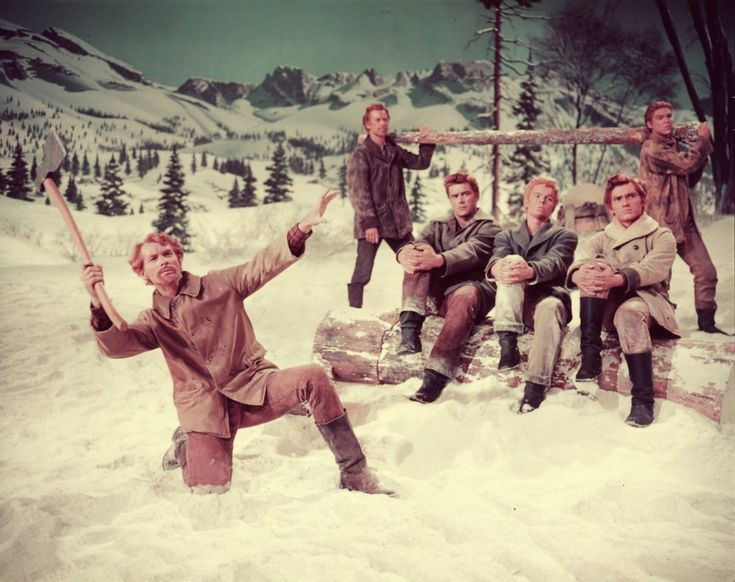 Adequately dressed for a long winter up in the mountains of Oregon, the seven brothers in Seven Brides for Seven Brothers (1954) look apiece in winter boots, jackets and heavy-duty trousers. But not a woolly hat between them, interestingly.