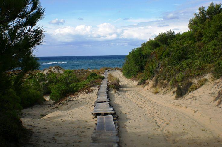 Your walkway to Mandraki beach is so romantic
