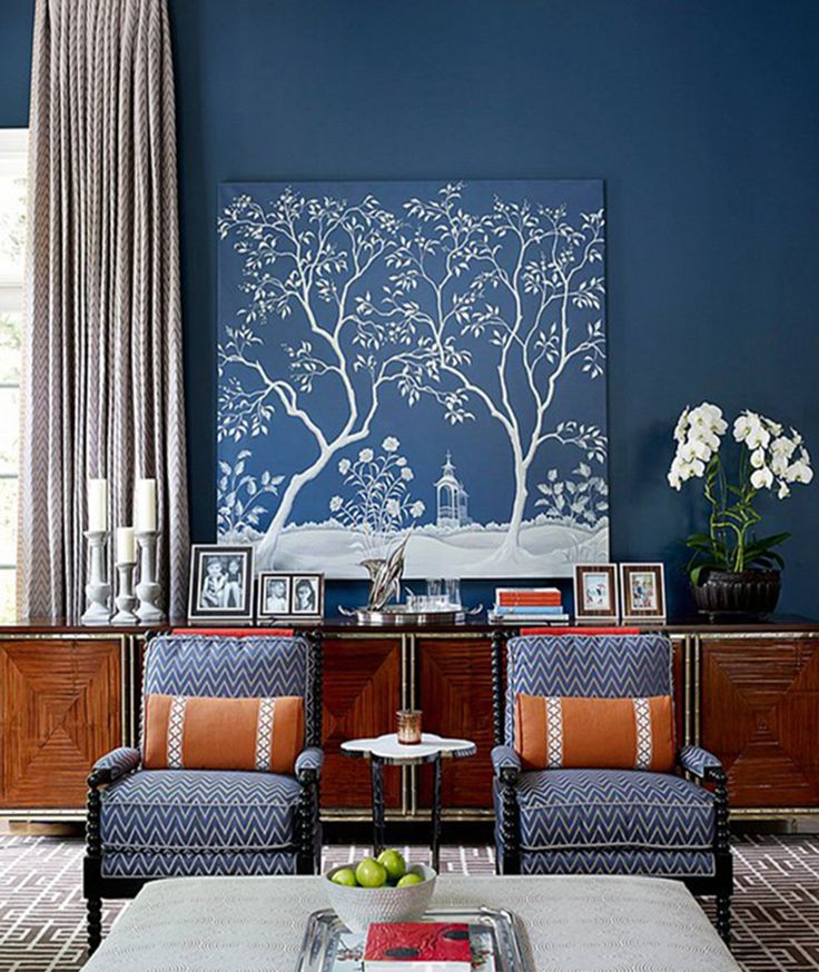 Feel like transforming a wall in your living room? Matching a chinoiserie print to the colour of your wall is a very chic idea. Add a flowering plant to enhance the floral theme.