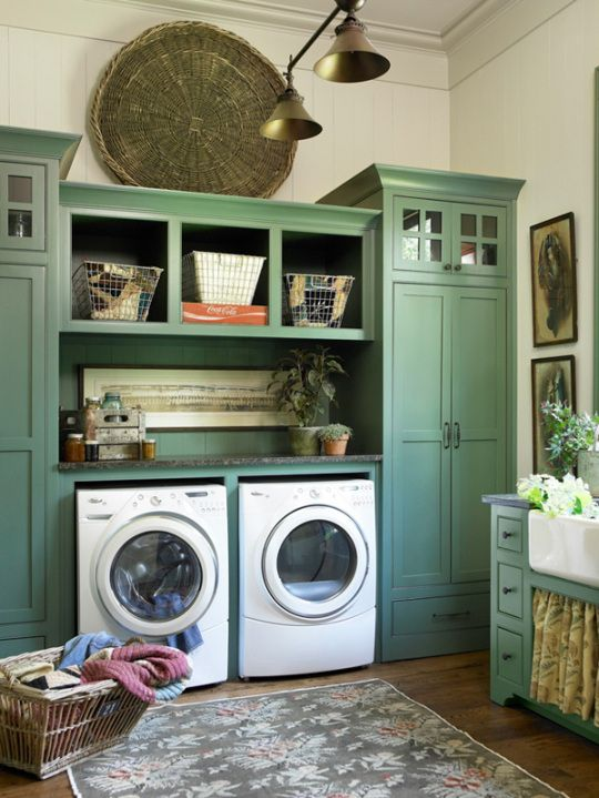 Oooh La La love the green built in cabinets in this laundry room. I might make the cabinet larger and use them as his and hers closets.