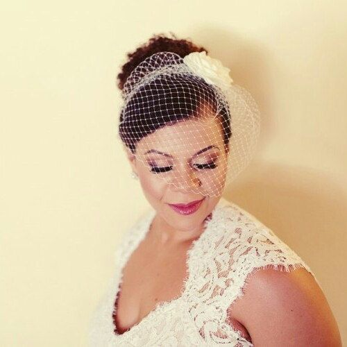 Lasr year bride wearing our big birdcage veil and a classic rose hair clip!