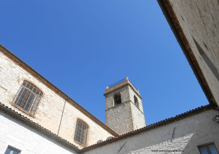 The cloister of St. Francis framing a clear sky above us - Arcevia - Marche - Italy