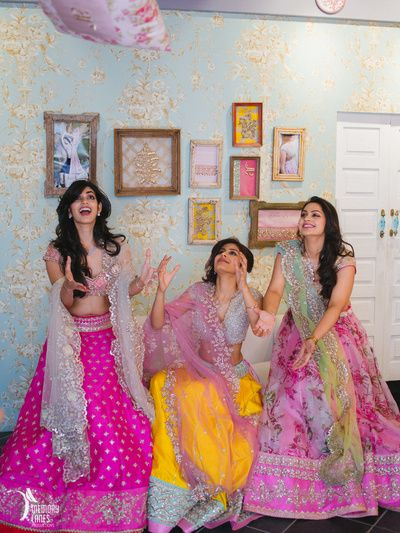 bridesmaids , elegant sister of the bride outfits , pink floral lehengas, girly pastel lehengas, engagement lehenga , sangeet lehenga , excited bridesmaids