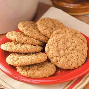 Oatmeal Cinnamon Cookies Recipe -My family loves these big old-fashioned cookies. They're crisp, yet still chewy in the center, and the cinnamon makes them a little different from typical oatmeal cookies.
