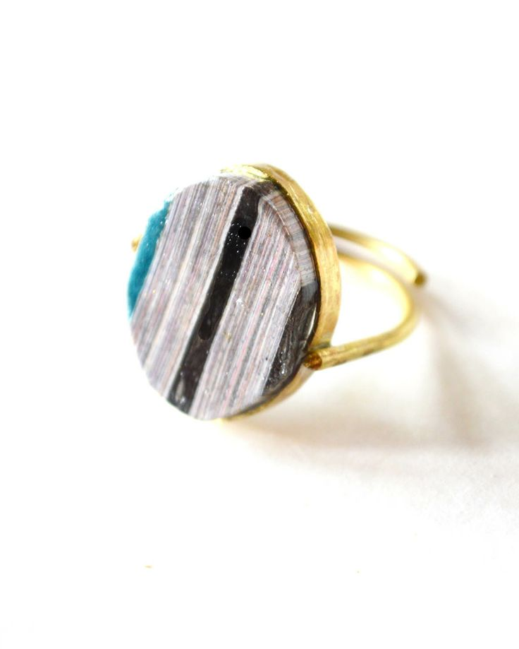 One Of A Kind ring by Quazi Design handmade from 100% waste magazine paper in Swaziland
