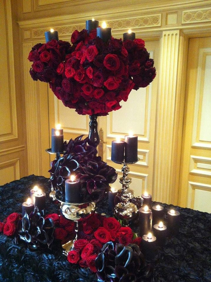 A tablescape like this one with red and black flowers by Jeff Leatham would be perfect for a nontraditional bride