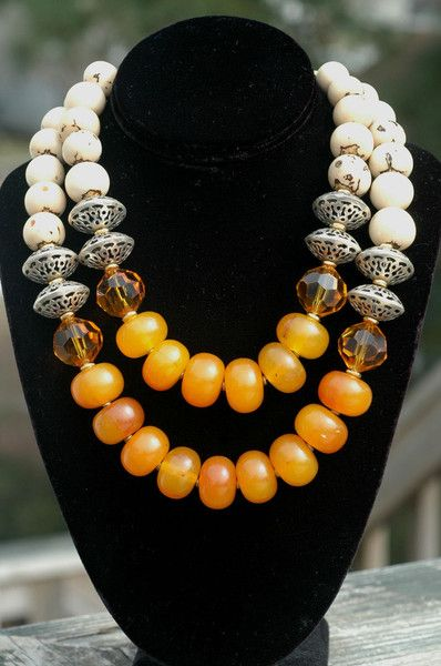 Amber, ivory, seed beads, and brass