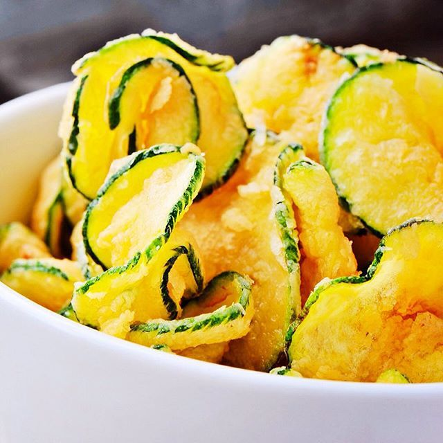 Zucchini Chips - Calories: 55 Yield: 1 serving(s) - INGREDIENTS: 1 Medium zucchini 1/2 tsp olive oil Pinch of salt - DIRECTIONS: Preheat oven to 300F. Cut the zucchini into thin slices 1/8 of an inch. Put into water with ice and chill for 10 minutes. Take out and dry each peace with a paper towel. Coat with Olive oil and salt. Spread the slices on a baking sheet and cook for about 20 minutes (turning once) or until golden brown. -=- #veggie #chips #recipe #zucchini #sidedish #snack #garden…