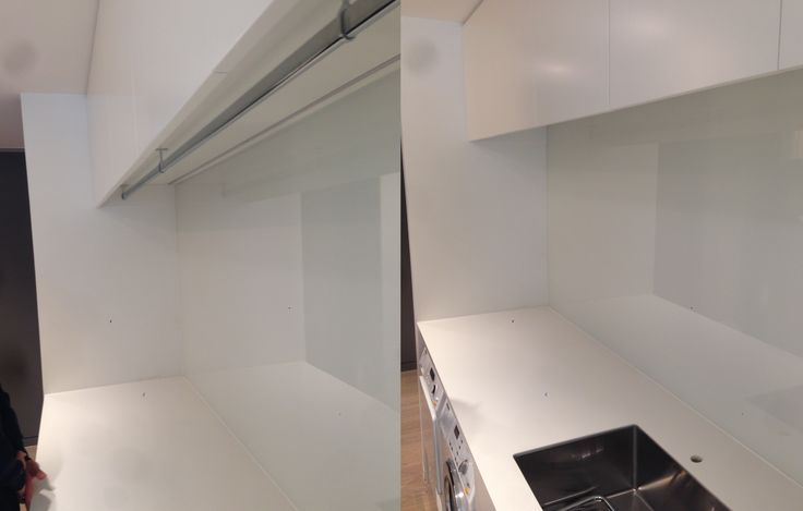 Concealed clothes rail under overhead cupboards