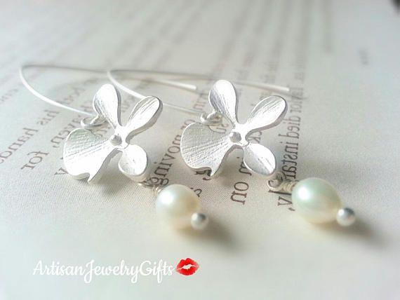 Matte silver orchid genuine white freshwater pearl earrings.