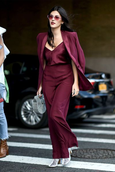 Burgundy pant suit with a satin top and silver accessories. I totally see myself wearing this to a christmas or new years party.