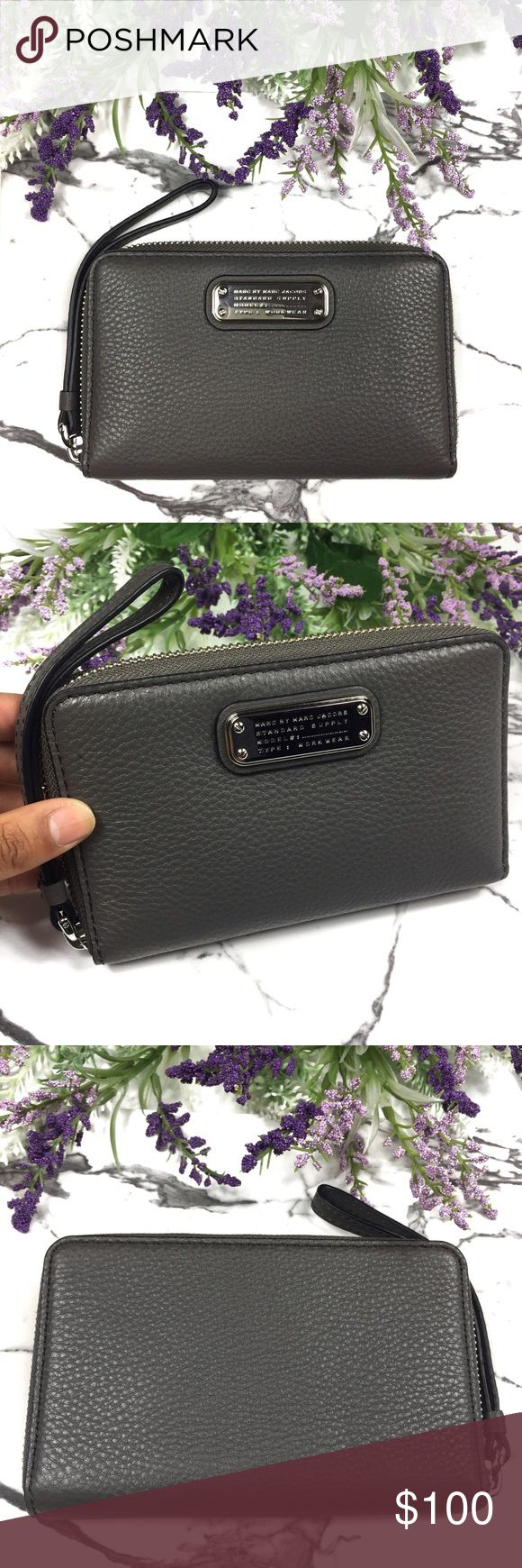 """Marc Jacobs New Q Wingman Leather Wristlet Wallet Brand NEW with tags! No signs of wear whatsoever. 100% Authentic.   MSRP: $148.00 + TAX!! 🚫TRADES **PRICE IS FIRM**  Color: Faded Aluminum  Pebbled Leather Model No: M0009418 Zip Around Wallet/Wristlet Sliver tone hardware Interior: Leather lining 1 open phone pocket,5 card slots, 1 clear ID slot, 1 zip pocket, 2 slip pockets Wrist strap zip pull Measurement:  4"""" x 6.25"""" x 0.75"""" Marc Jacobs Bags Clutches & Wristlets"""