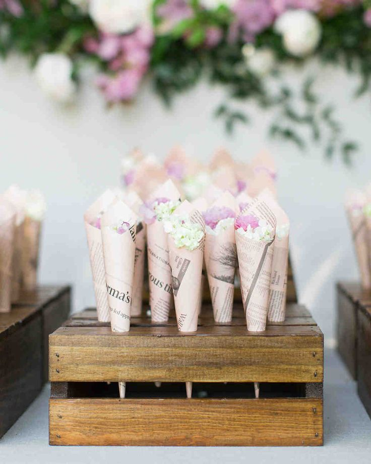 Trending Now: Wedding Ceremony Petal Bars | Martha Stewart Weddings - For a vintage-inspired celebration, you can't go wrong with these newspaper print cones filled with colorful flower petals. Set them up in wooden crates and encourage guests to grab a bundle on their way into the ceremony.