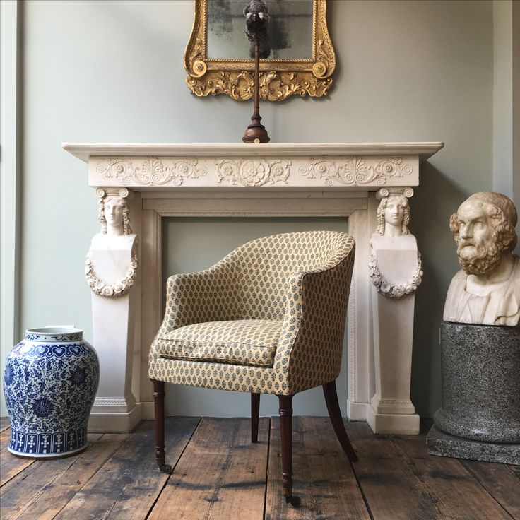 The Fawley #armchair sits in front of a good early 19th century Regency Greek revival carved statuary #antique #marble #fireplace.