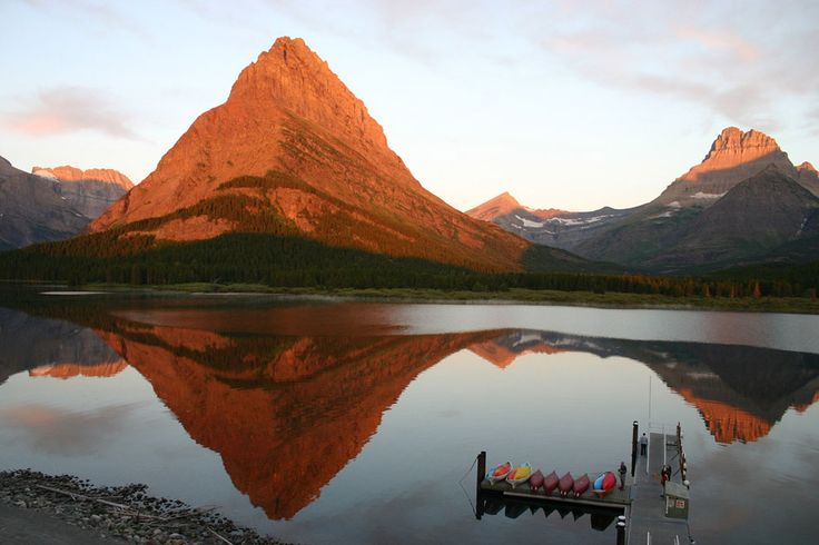 Sunrise in Glacier: I took this from the balcony of Many Glacier Lodge in Glacier National Park, on August 1, 2012. The sun was rising behind me and onto the mountains. (© Sharon Lyon/National Geographic Photo Contest)