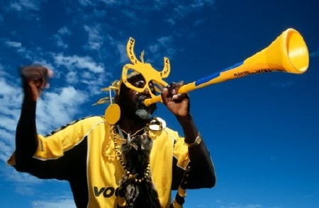 Soccer fan with vuvuzela.