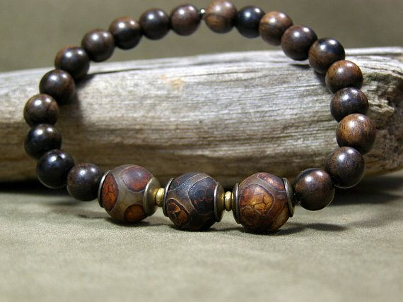 A rich dark stretch bracelet for men beaded in dark mala wood beads and gorgeous ancient tortoise agate stones. Beaded on strong stretch cord