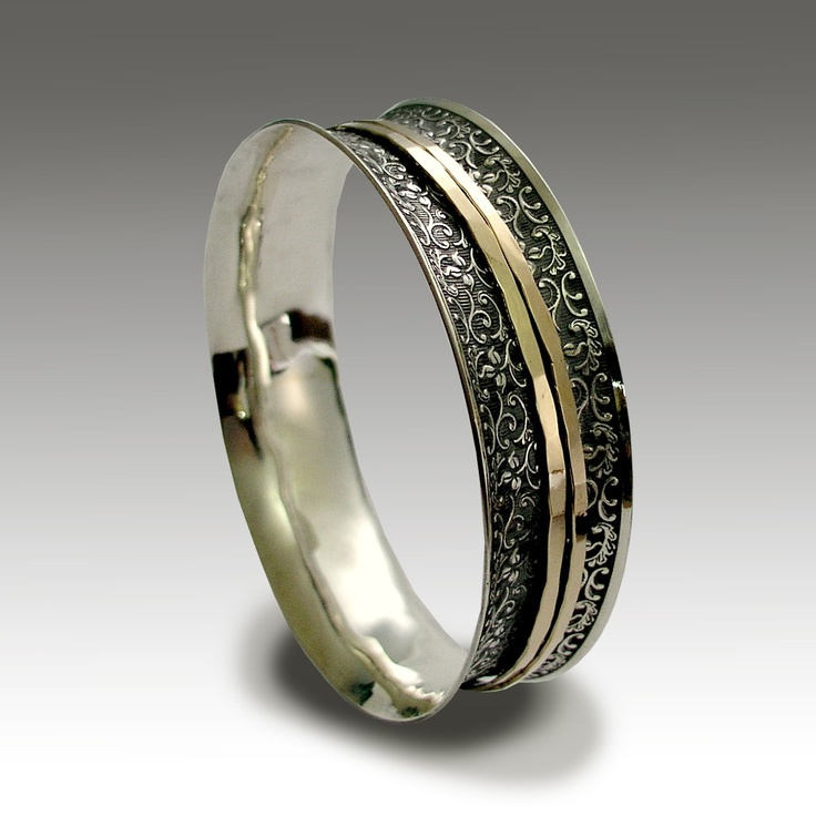 Sterling silver filigree bangle with gold filled spinners - Possibly maybe. $586.00, via Etsy.
