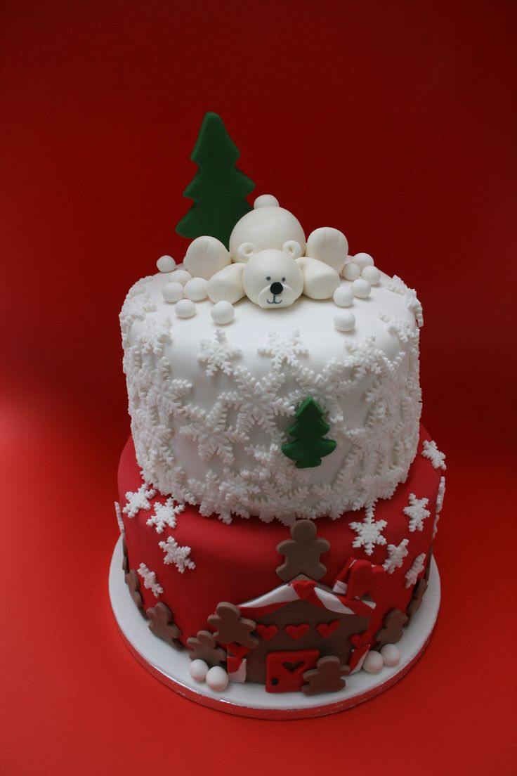 Christmas inspired - A birthday cake for 2 teenage girls and they wanted a Christmas inspired one so the top tier was with snowflakes and the polar bear all done with fondant and the bottom tier was a gingerbread house. The bottom tier was inspired by DeVoli Cakes
