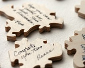 guests sign a puzzle piece, put it back together, frame it