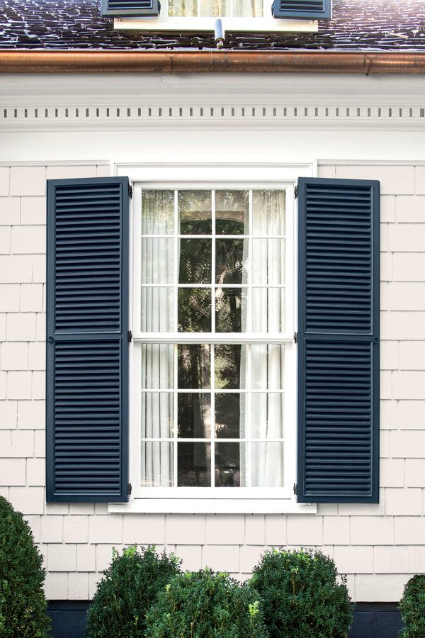 Siding: Polo Mallet White (RL1051); ralphlaurenpaint.com Shutters: Evening Dove (2128-30); benjaminmoore.com
