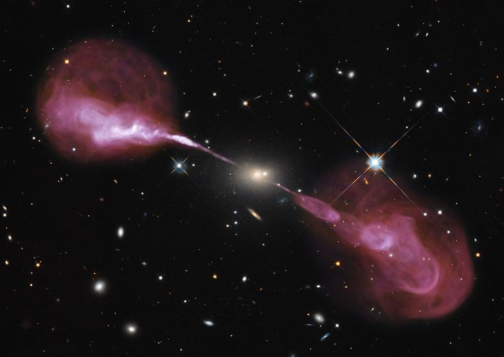 Spectacular jets powered by the gravitational energy of a supermassive black hole in the core of the elliptical galaxy Hercules