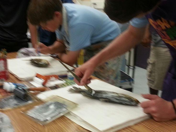 Pin fish fins to foamboard
