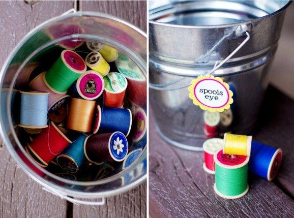 GAME:  throw spools of thread into the bucket...stand behind a measuring tape line too! #lalaloopsy #party #game