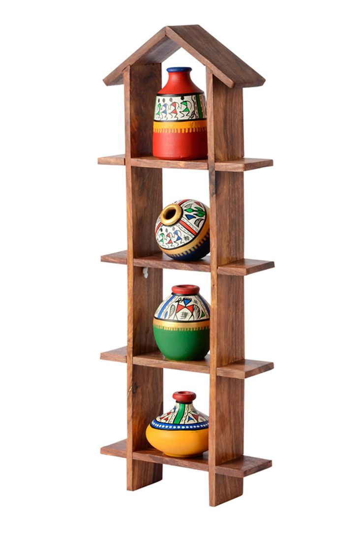 Creatively hands painted #multicolored assorted set of 4 #pots have been uniquely placed on a sheesham #wooden hut shaped frame to add color and life to your #wall.