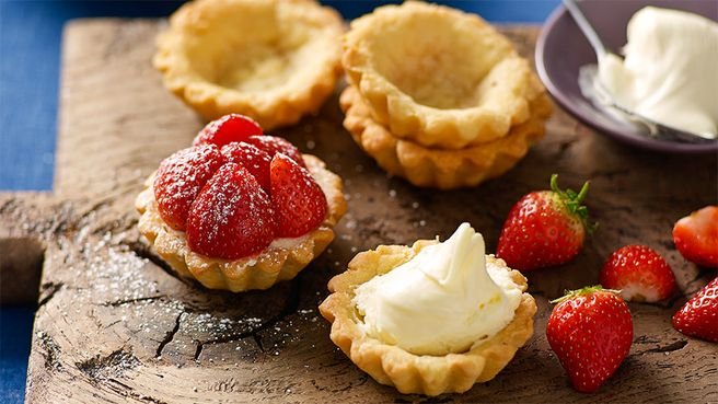 Brown-butter pastry, strawberry and cream tartlets